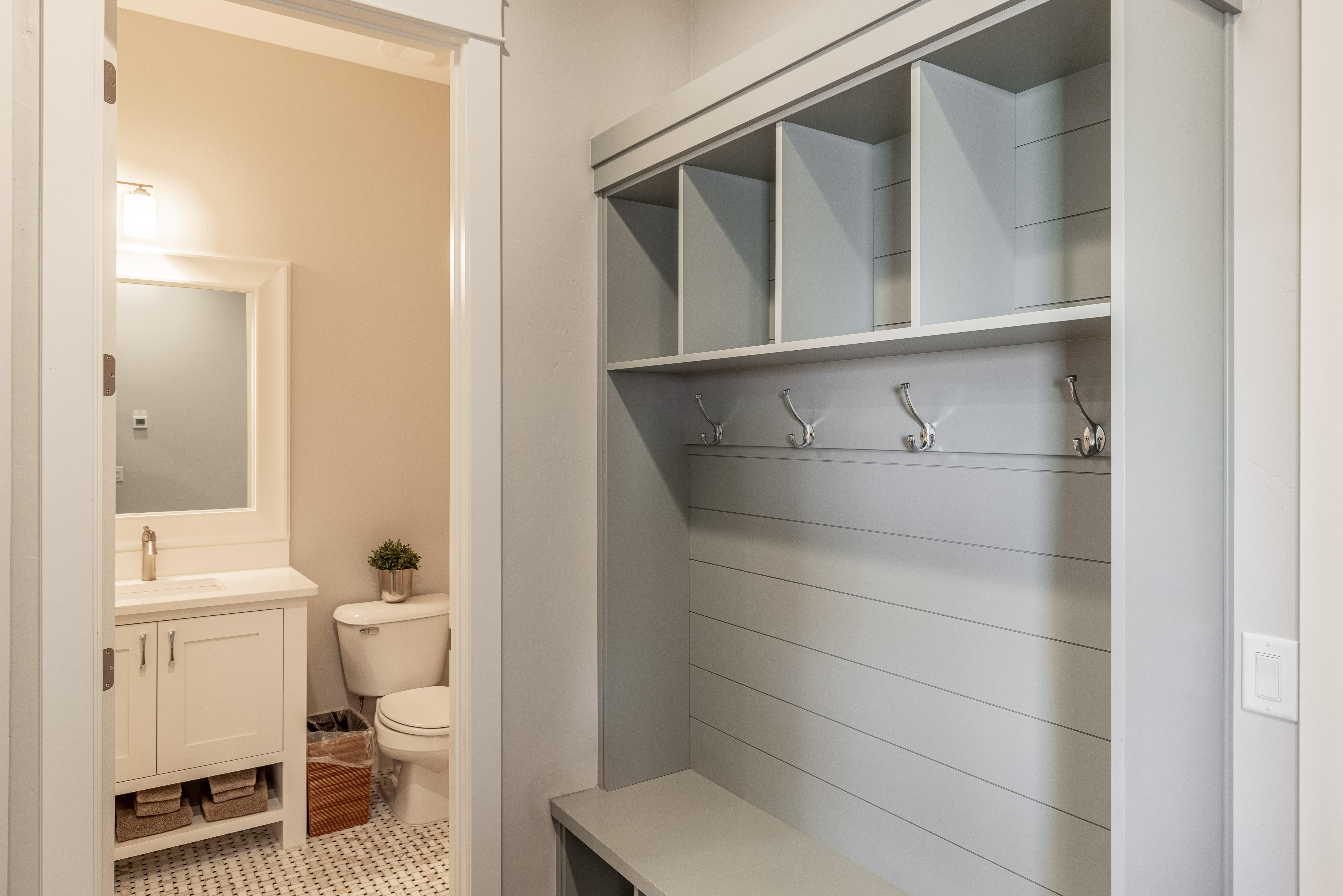 Mud room & half bathroom conveniently located for your guests.