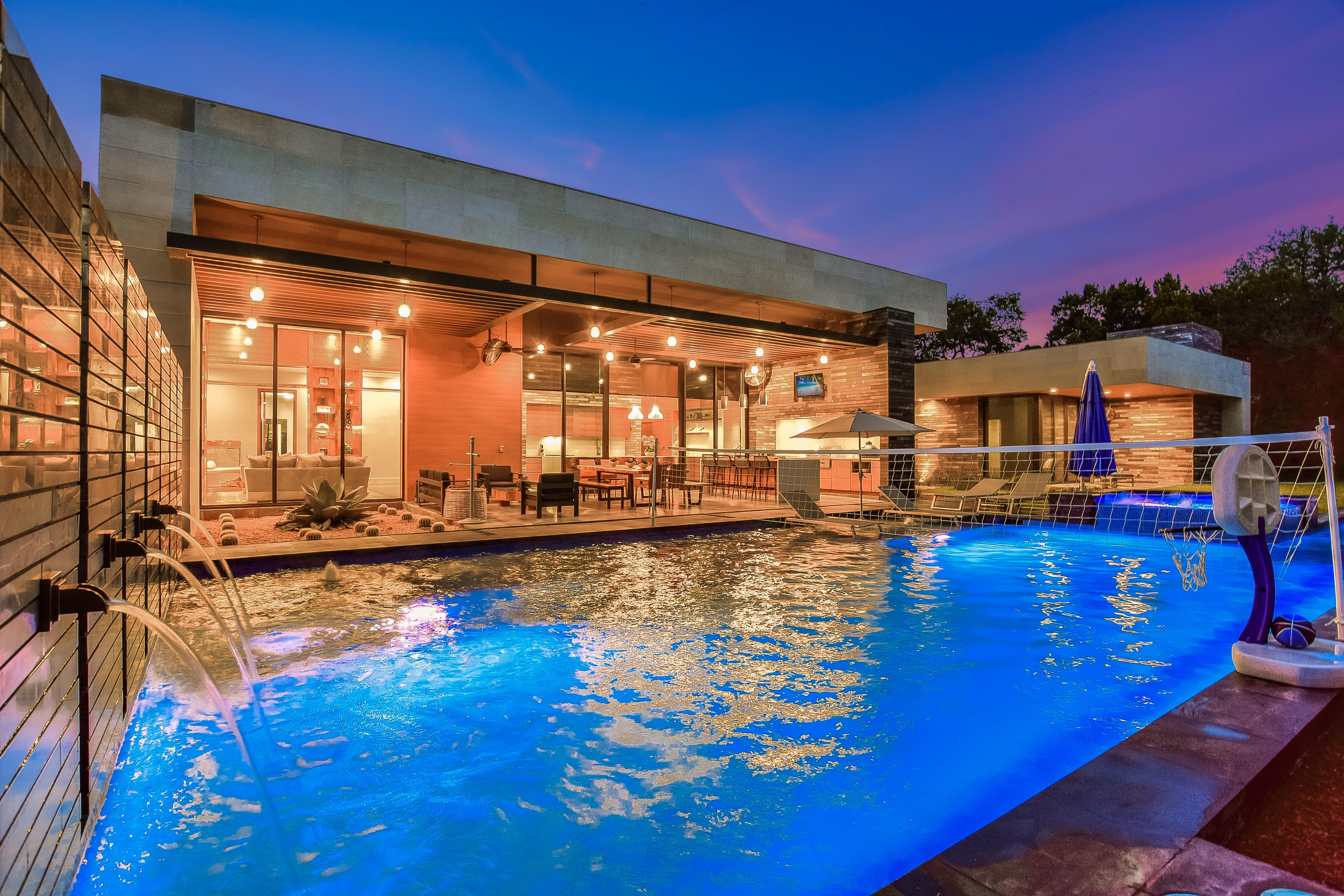 Incredible pool with multiple water features, a pool volleyball net, jacuzzi and lap pool.  Jump in and enjoy this paradise!