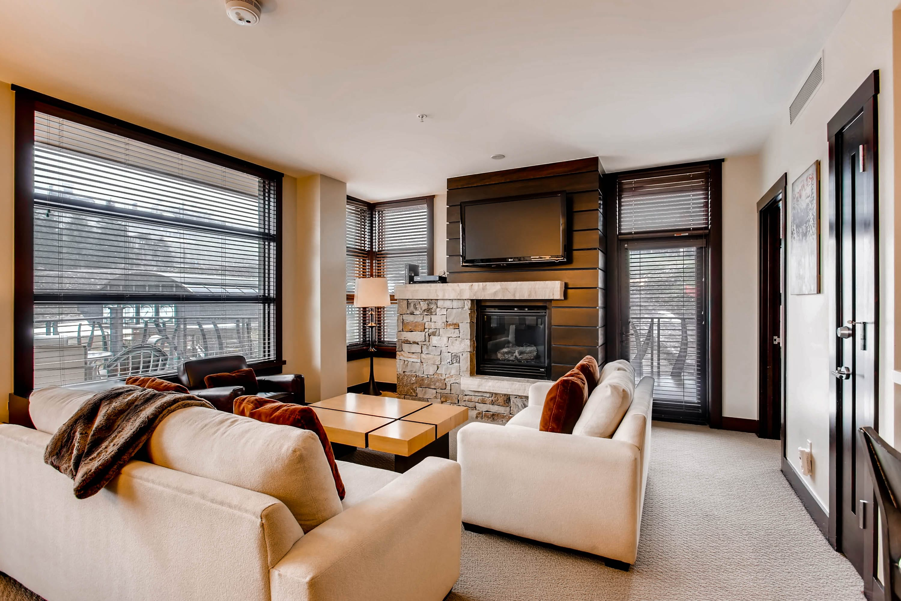 Luxury corner residence in Hayden Lodge with huge wrap around balcony and iconic Snowmass Mountain views