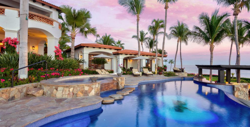 Elegant and Expansive Beachfront Property in Exclusive Community