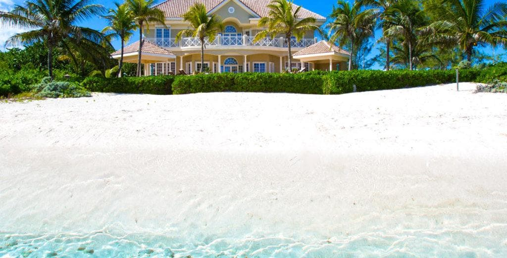 Polished Mansion steps away From Rum Point Beach
