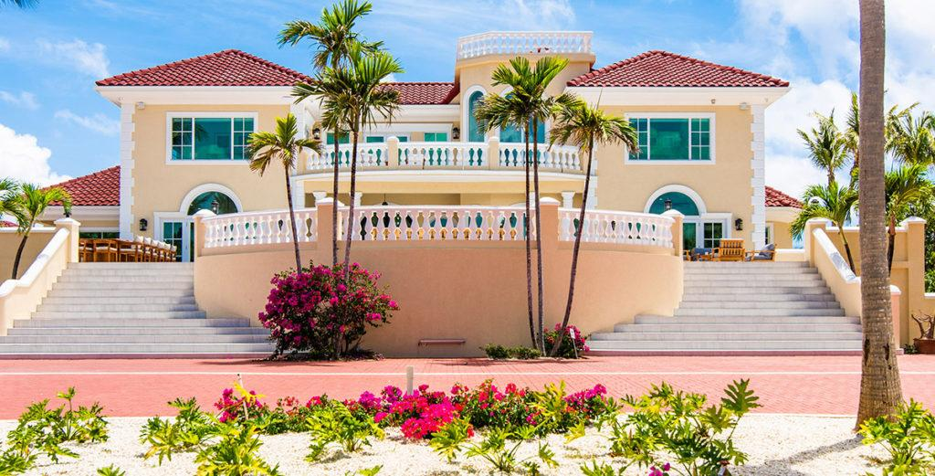 Magnificent Spanish-Tiled Villa with Oceanfront Pool in Rum Point