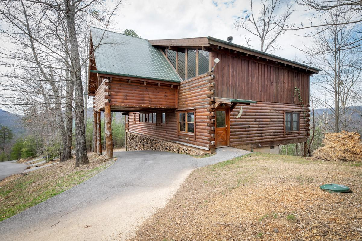 Property Image 1 - Vivacious Cabin with Wrap-Around Deck and Porch Swing