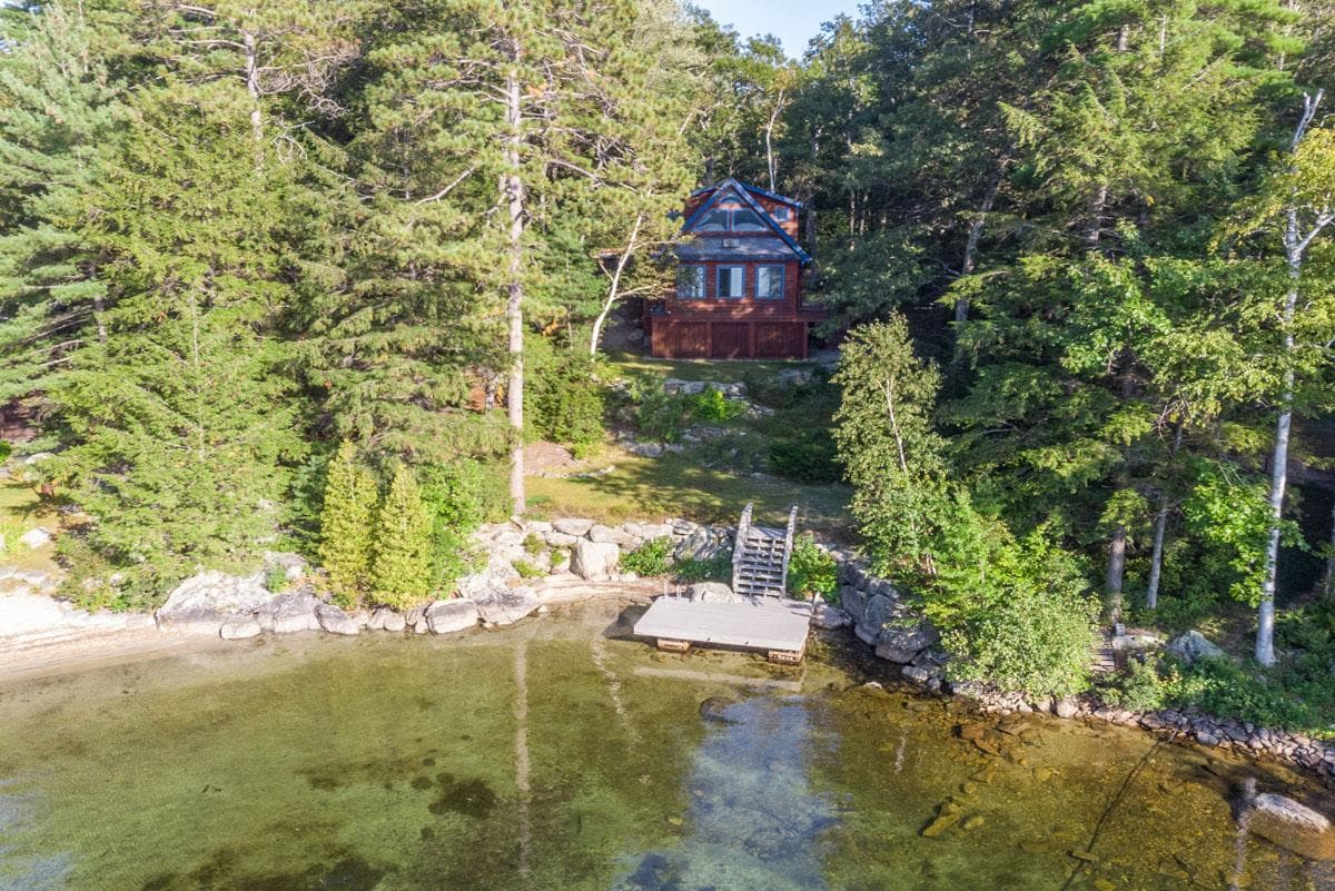 Newly Renovated, Waterfront Home on Wooded Grounds and Sweeping Views
