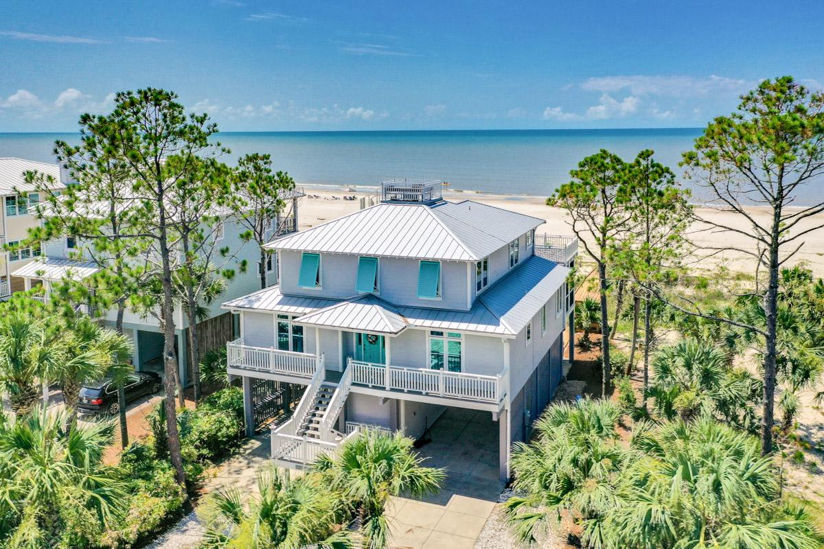 Stunning beachfront home with screened in porch, private boardwalk, and hot tub