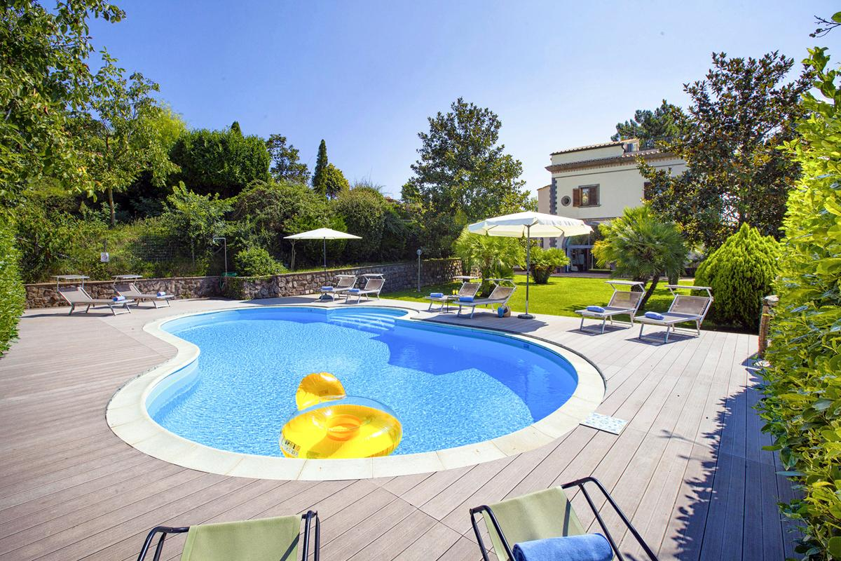 Charming Villa with Pristine Lawns and Pool