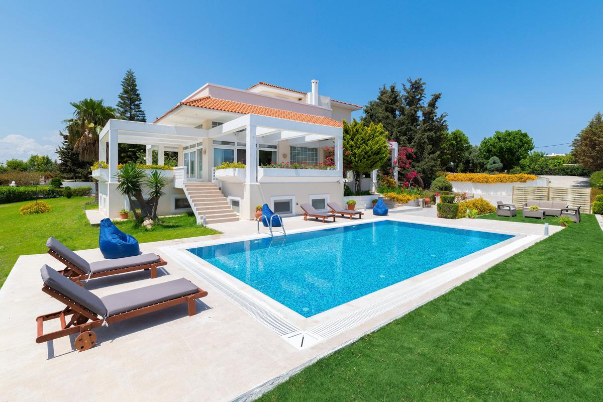 Property Image 1 - Stylish Villa with Coastal Views, Garden, and Pool