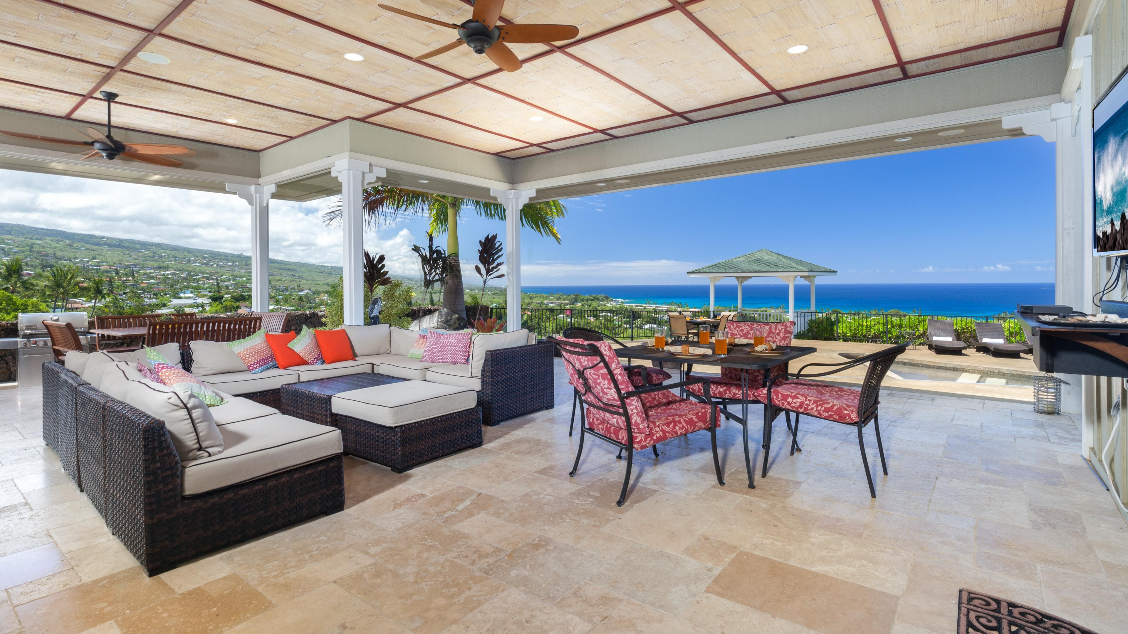Large Covered Lanai with stunning ocean view and multiple outdoor tables for dining or games night