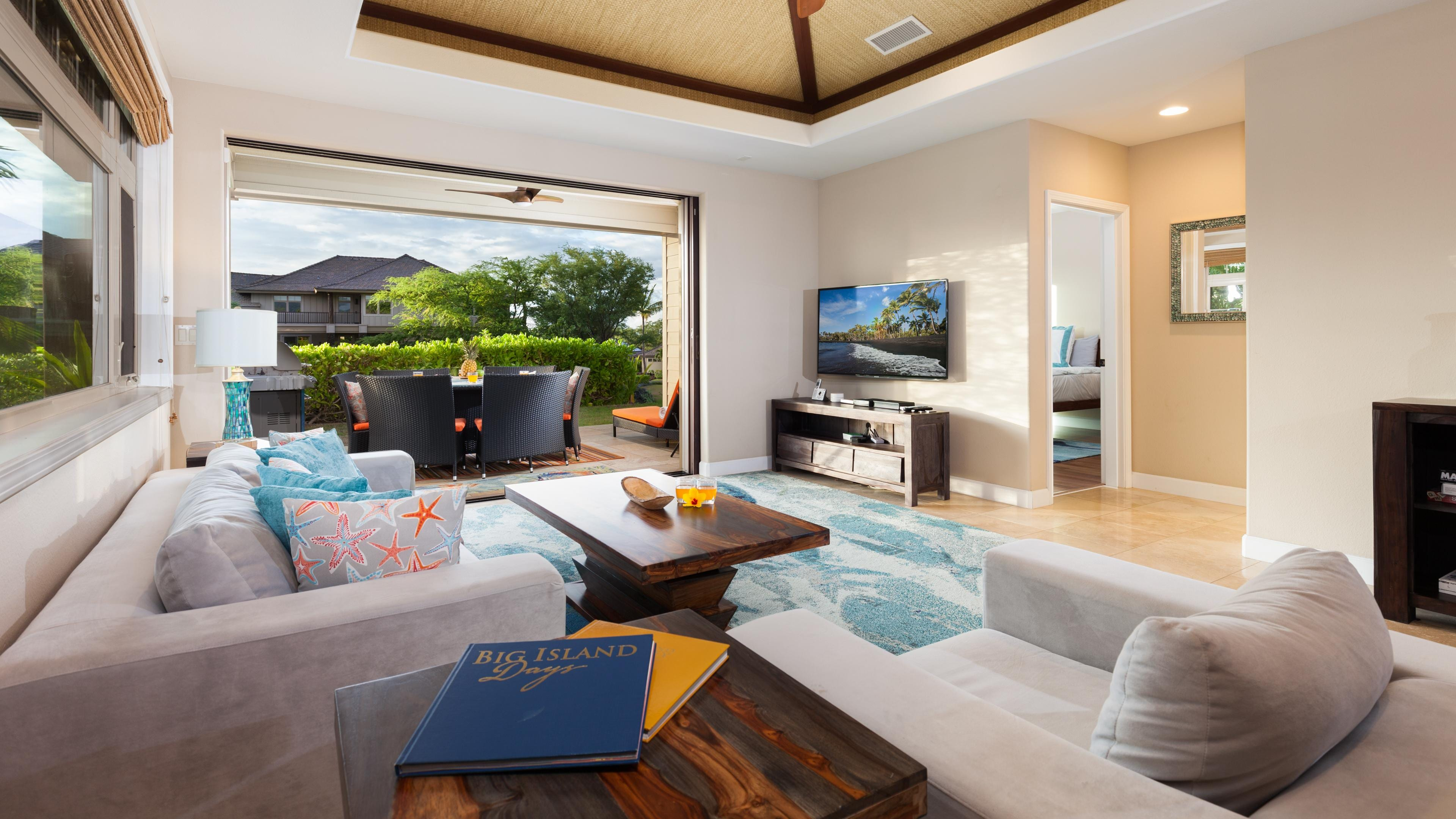 Open concept living area with pocket doors leading to the covered lanai
