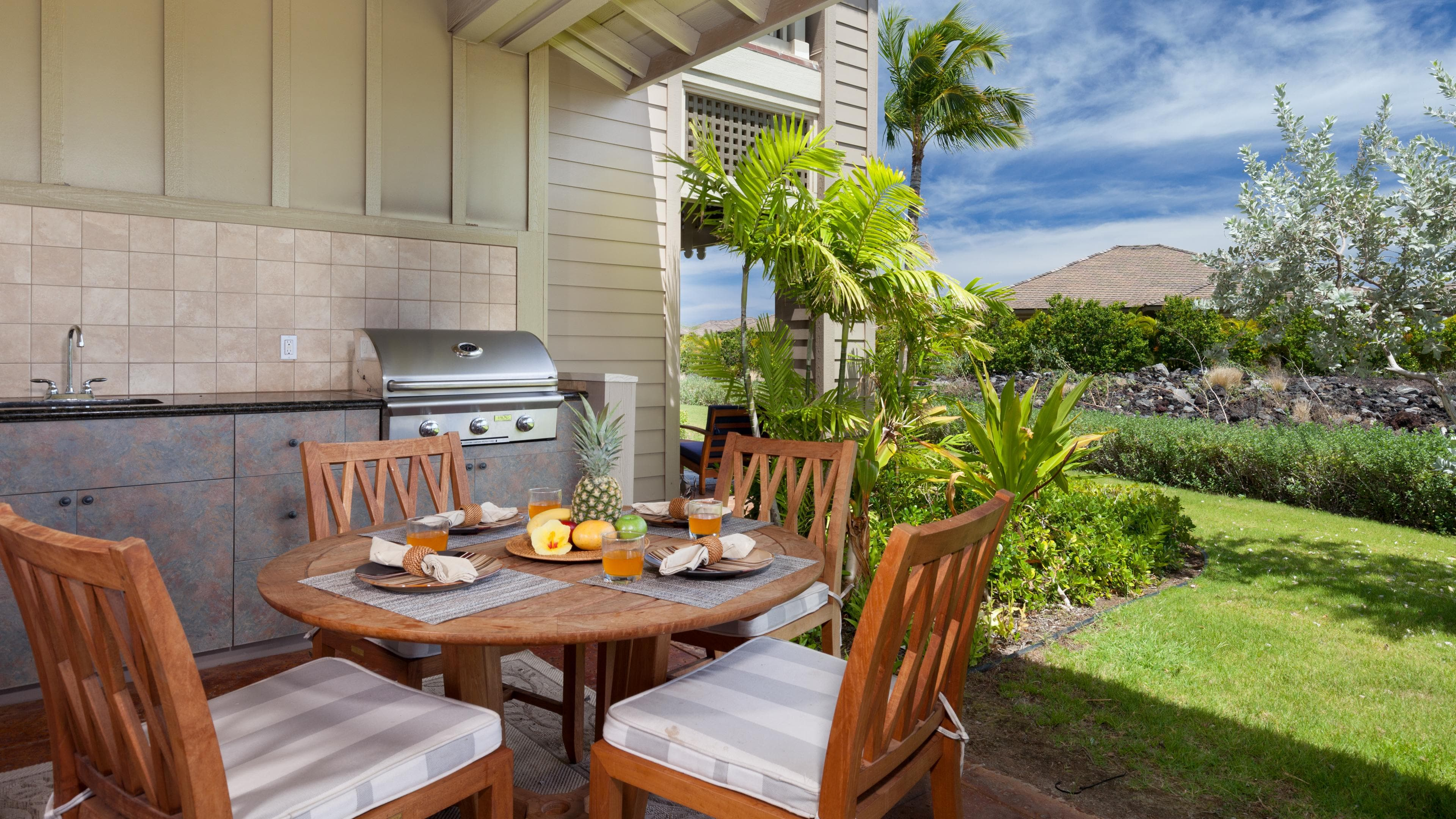 Covered lanai with private high end grill.