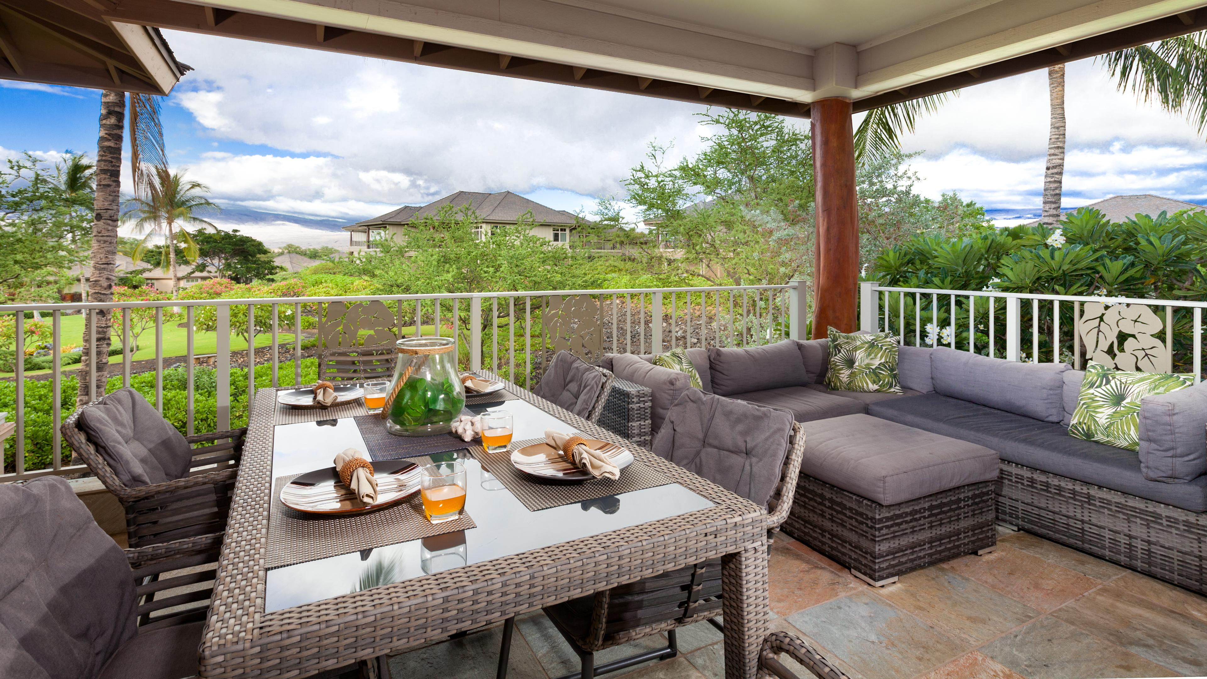 Large covered lanai with view of the putting green and gardens and Kohala Mountain
