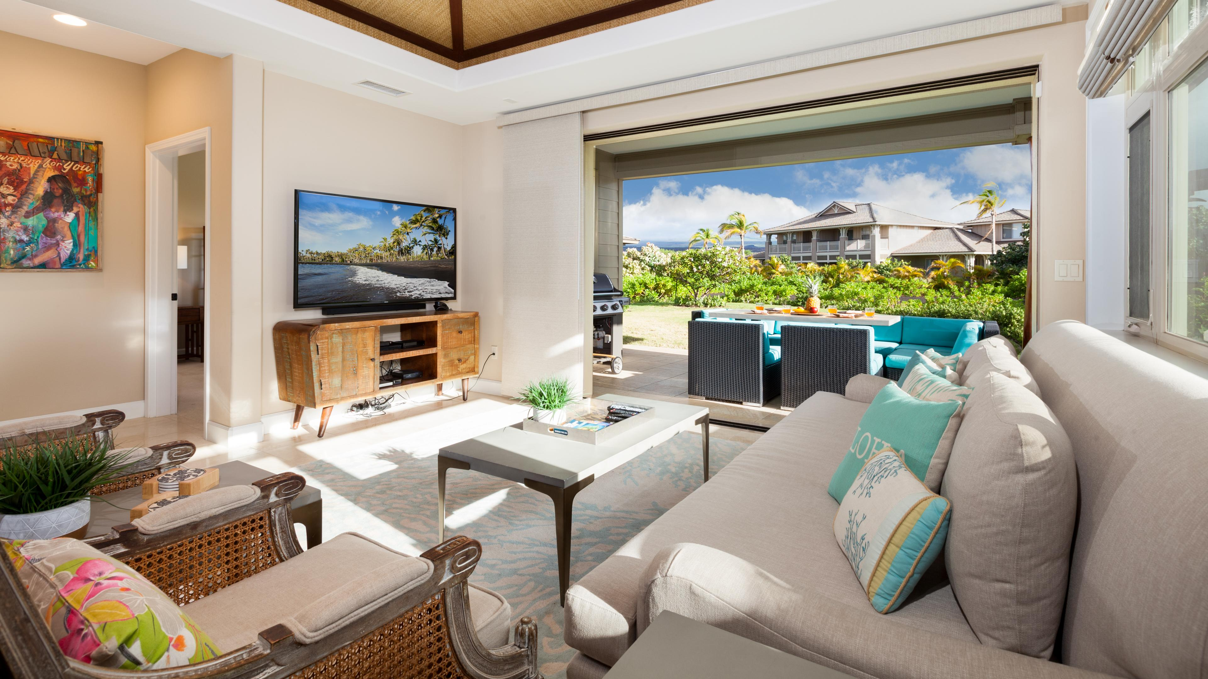 Large living room with pocket door to lanai outdoor dining and living area