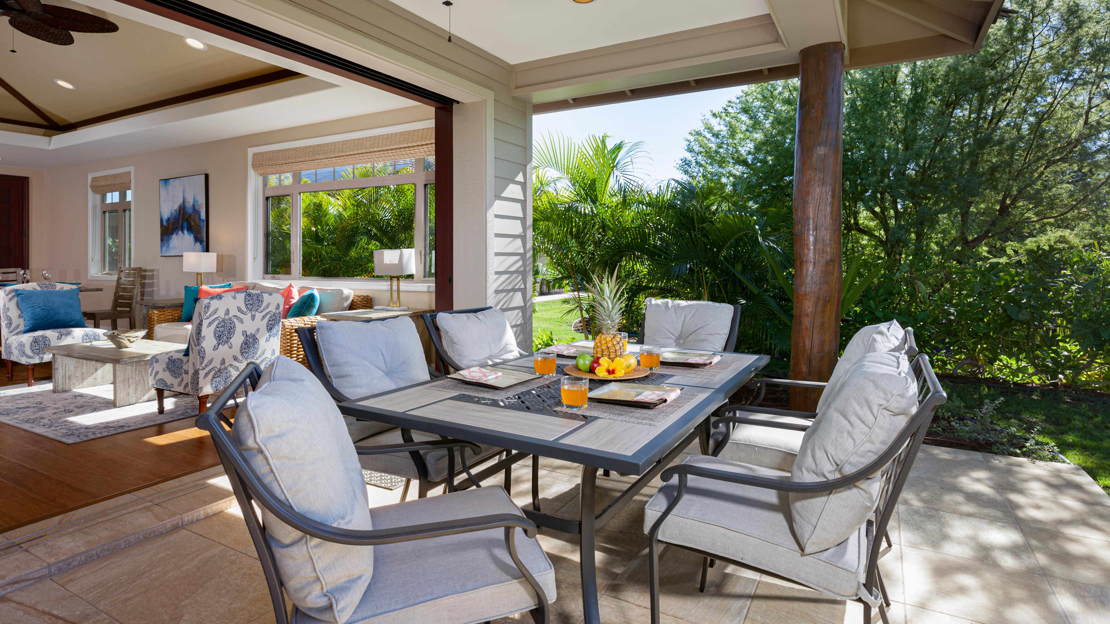 Covered lanai with large pocket doors that blend indoor and outdoor living