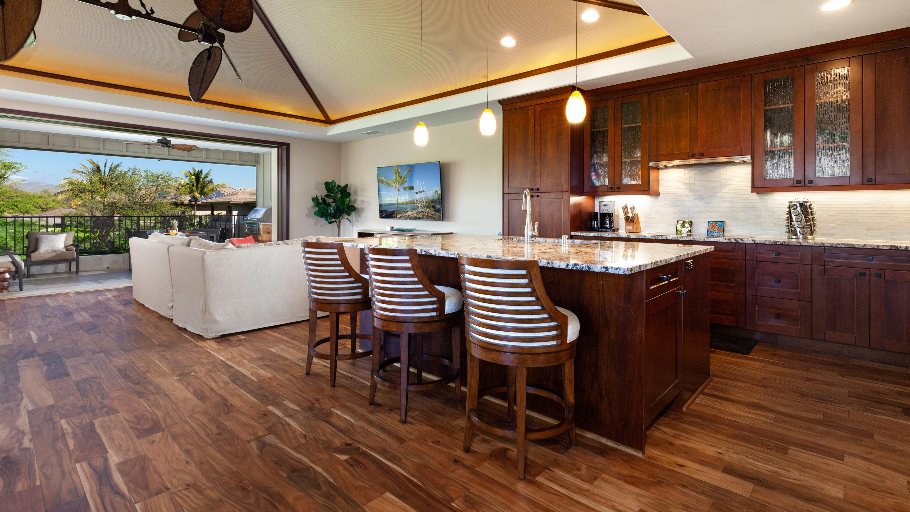 Mauna Kea Sunrise has a large open concept main floor living room including pocket doors that open up to a large covered outdoor living area called a Lanai