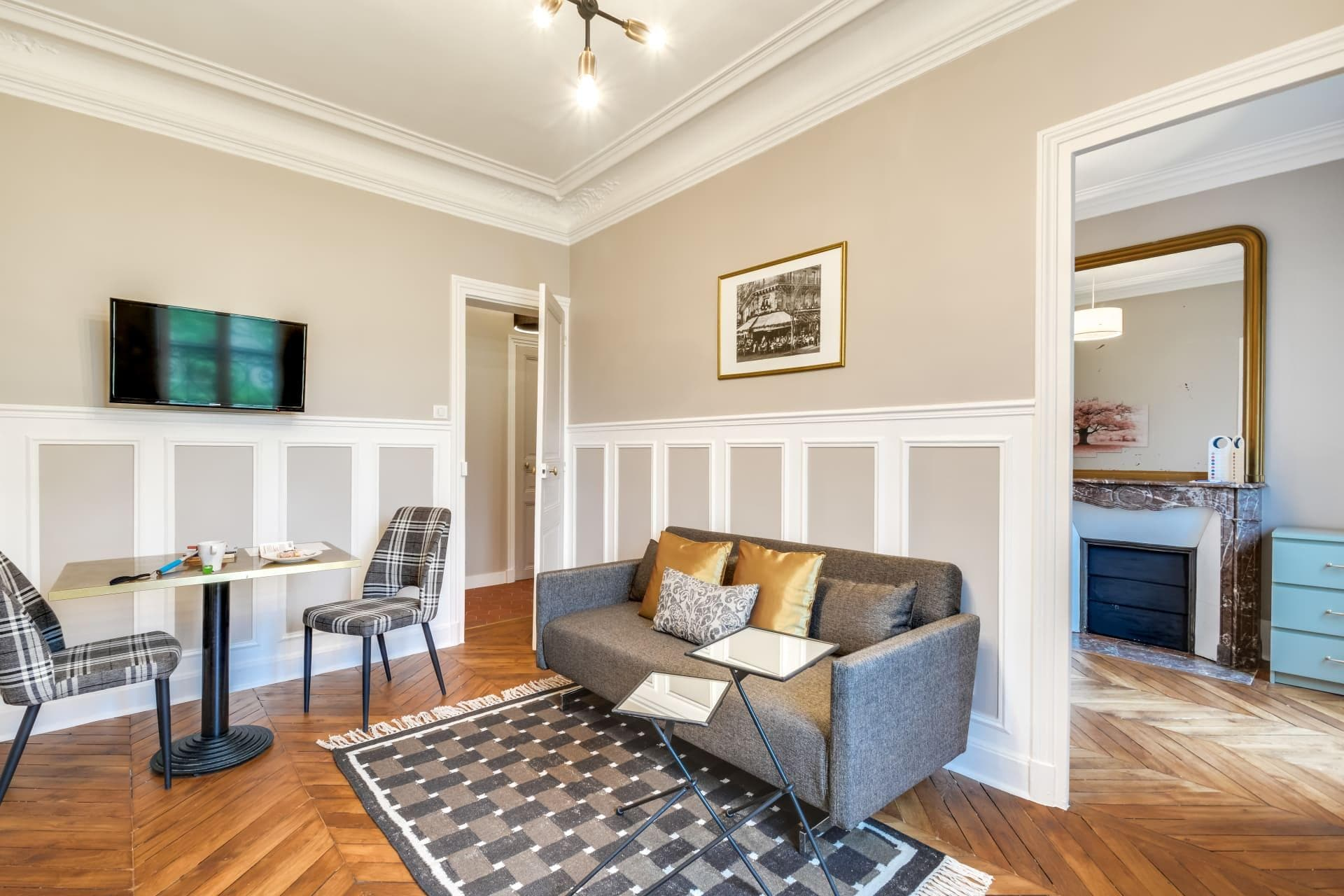 Elegant White Paneled One Bedroom Apartment with a Marble Fireplace